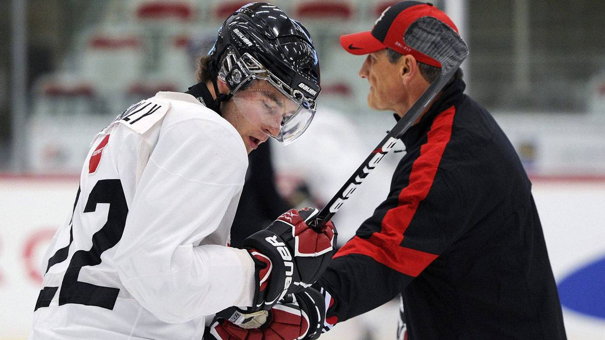 Team Canada's Brett Connolly gets a hand from head coach Don Hay during the Team White practice at the Canadian national junior hockey team selection camp practice in Calgary, Dec.11, 2011.