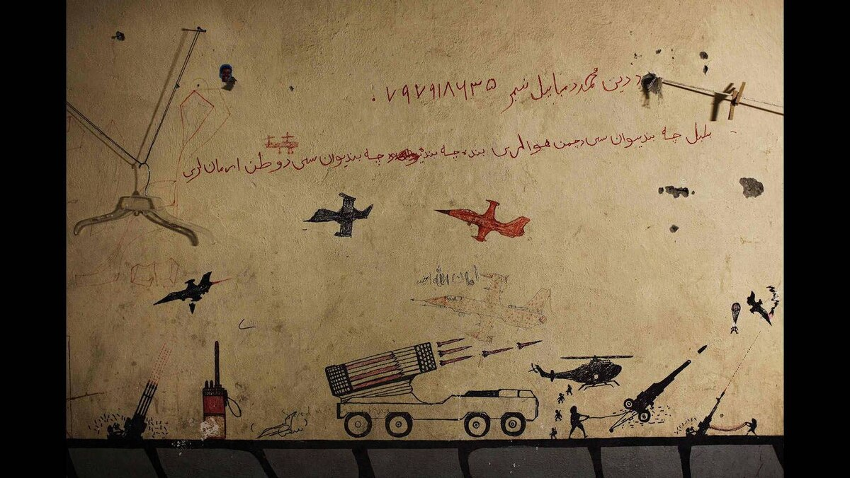 Graffiti left behind by Taliban fighters remains on the walls of a compound now used as a command center for the U.S Marine Corps's First Battalion, Eighth Marines at Musa Qala in southern Afghanistan's Helmand province, November 10, 2010.