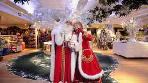 Father Christmas and Mrs Christmas pose for photographers at Harrods department store in central London on July 28, 2011,