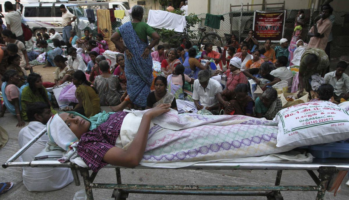 Patients rest in the lawns of a government-run hospital after they were evacuated in the southern Indian city of Chennai April 11, 2012, following an earthquake which struck off Indonesia.