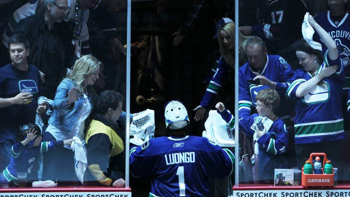 Vancouver Canucks goalie Roberto Luongo makes his way back to the dressing room after the they beat Boston Bruins 1-0 in Game 5.
