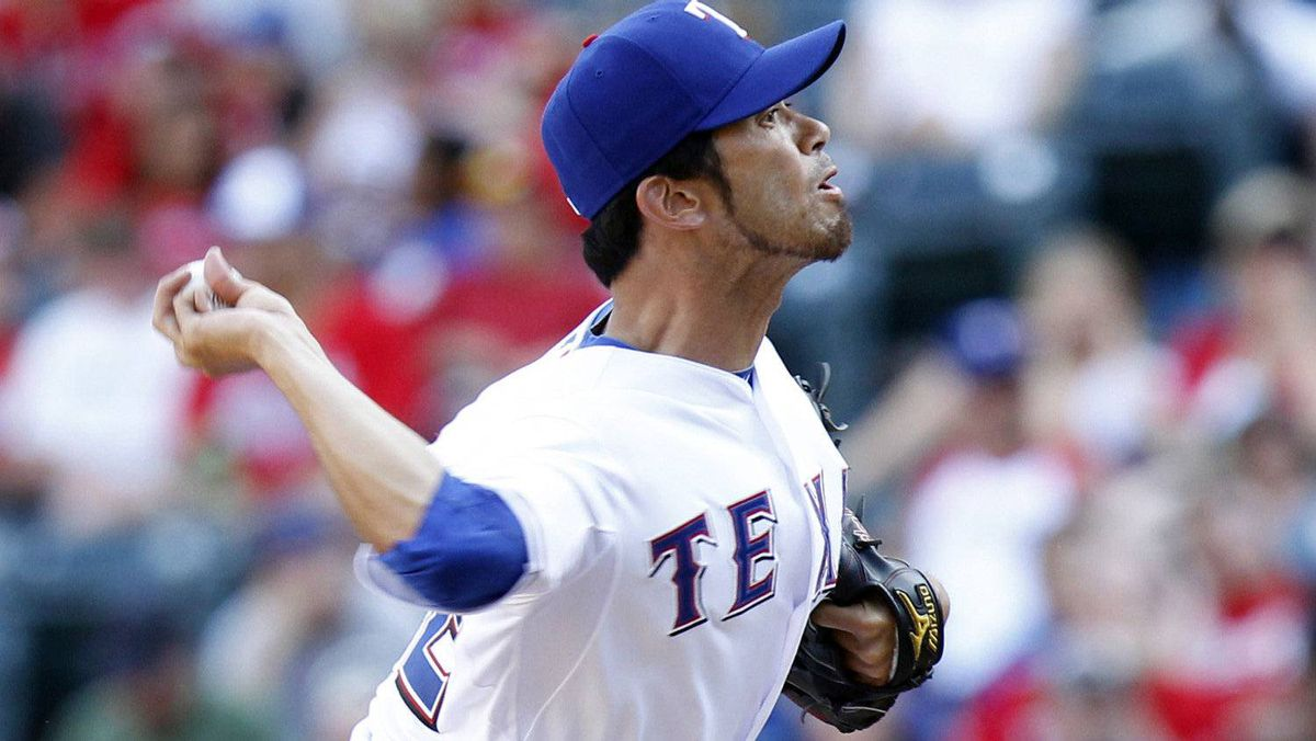 Texas Rangers pitcher Yoshinori Tateyama pitches against the Toronto Blue Jays in the thirtheenth inning of their MLB American League baseball game in Arlington, Texas May 26, 2012. REUTERS/Mike Stone