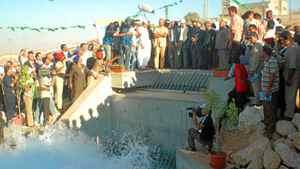 The son of Libyan leader Moammar Gadhafi, Seif al-Islam, centre, in khaki, has had a long relationship with SNC-Lavalin.