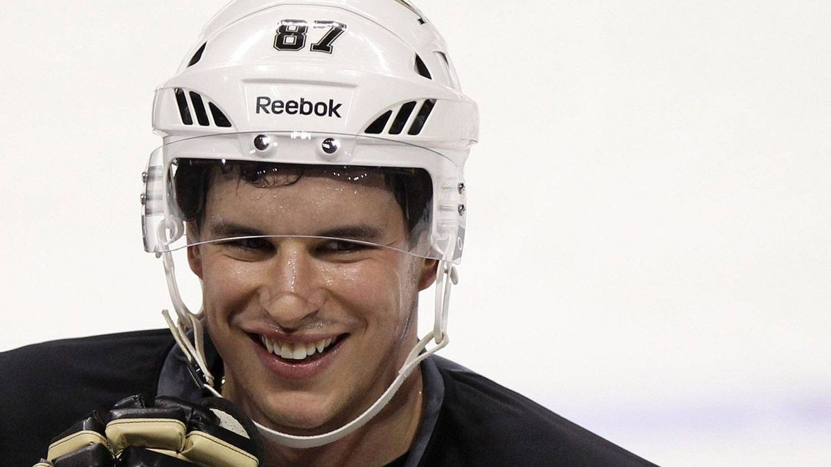 Pittsburgh Penguins centre Sidney Crosby smiles during practice in Montreal, Feb. 7, 2012.