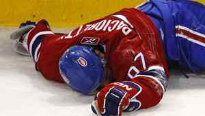 Montreal Canadiens Max Pacioretty lies on the ice after being hit into a glass stanchion by Boston Bruins defenceman Zdeno Chara during the second period of NHL hockey play in Montreal, March 8, 2011.