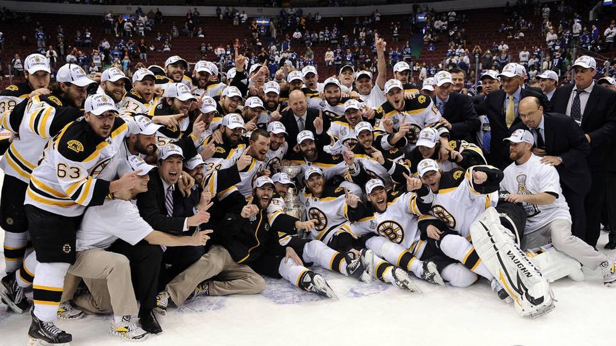 The Boston Bruins pose with the Stanley Cup after defeating the Vancouver Canucks in Game 7.