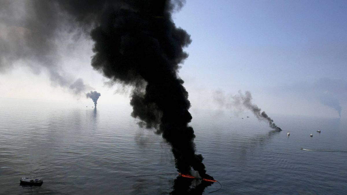 Smoke billows from a controlled burn of spilled oil off the Louisiana coast in the Gulf of Mexico coast line June 13, 2010