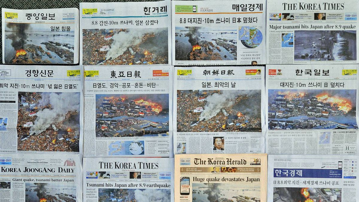South Korean newspaper front pages show coverage of the Japan earthquake on March 12, 2011.