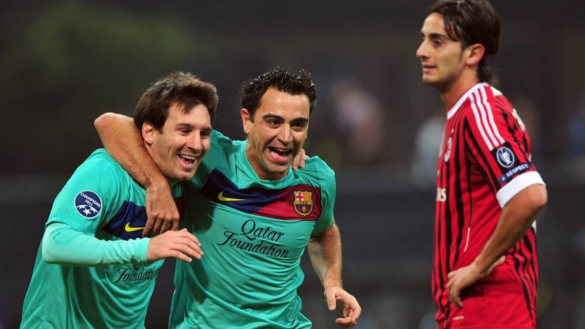 Barcelona's Argentinian forward Lionel Messi, left, and teammate midfielder Xavi Hernandez celebrate in front of AC Milan's midfielder Alberto Aquilani.