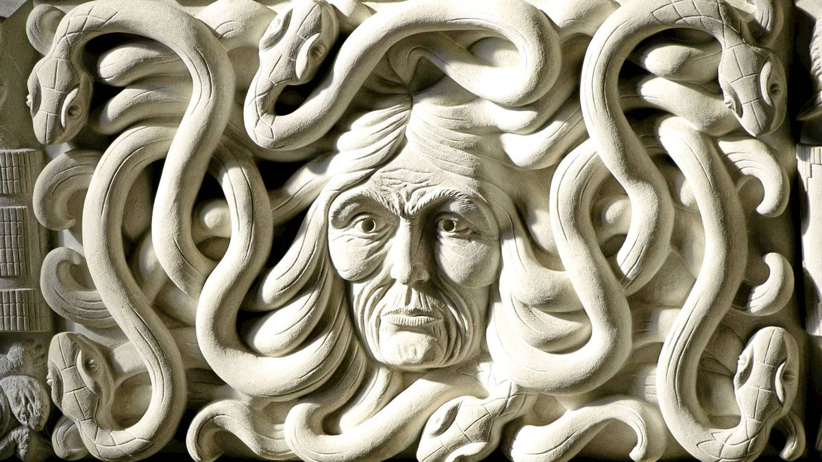 A sculptured face with snakes for hair is hit by morning light inside the House of Commons foyer entrance on Parliament Hill in Ottawa on Thursday, March 24, 2011.