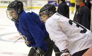 Canadian national junior team players Tyler Seguin, left, fromt the Plymouth Whalers, and Taylor Hall, from the Windsor Spitfires, take a break during practice Monday.
