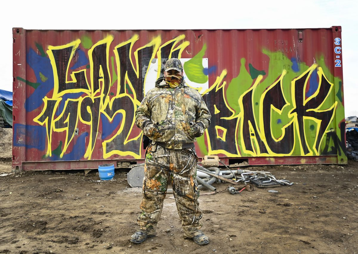 graffiti mural reading 1492 Land Back Lane