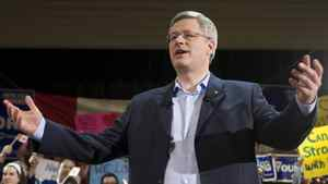 Prime Minister Stephen Harper waves as he makes a campaign stop in Burnaby, B.C. on Sunday March 27, 2011.