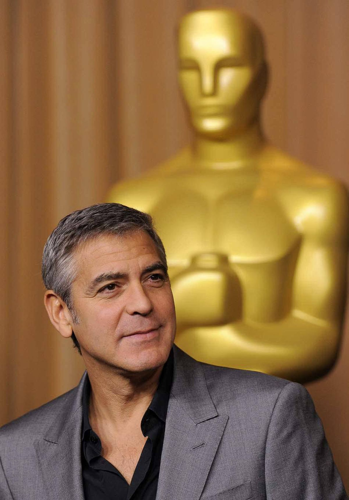 A bemused George Clooney arrives at the Academy Awards nominees luncheon in Beverly Hills, Calif., on Monday.