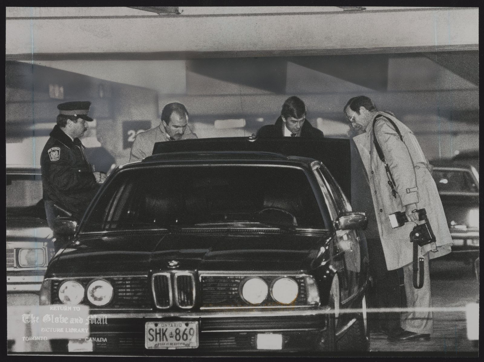 Paul VOLPE Toronto. Police examine the BMW car in which Paul Volpe's body was found in a multi-story parking garage at Toronto airport.