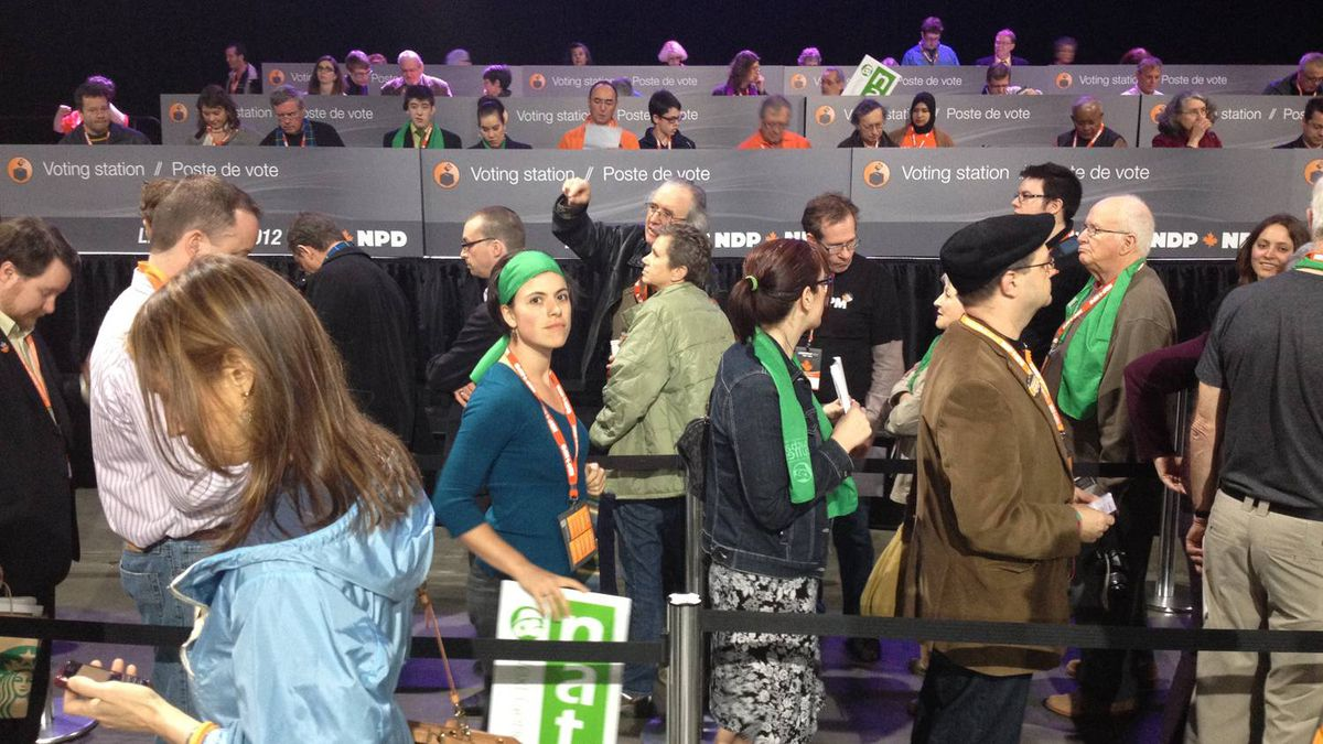 Delegates line up to vote on the second round of the NDP leadership election in Toronto on March 24, 2012.