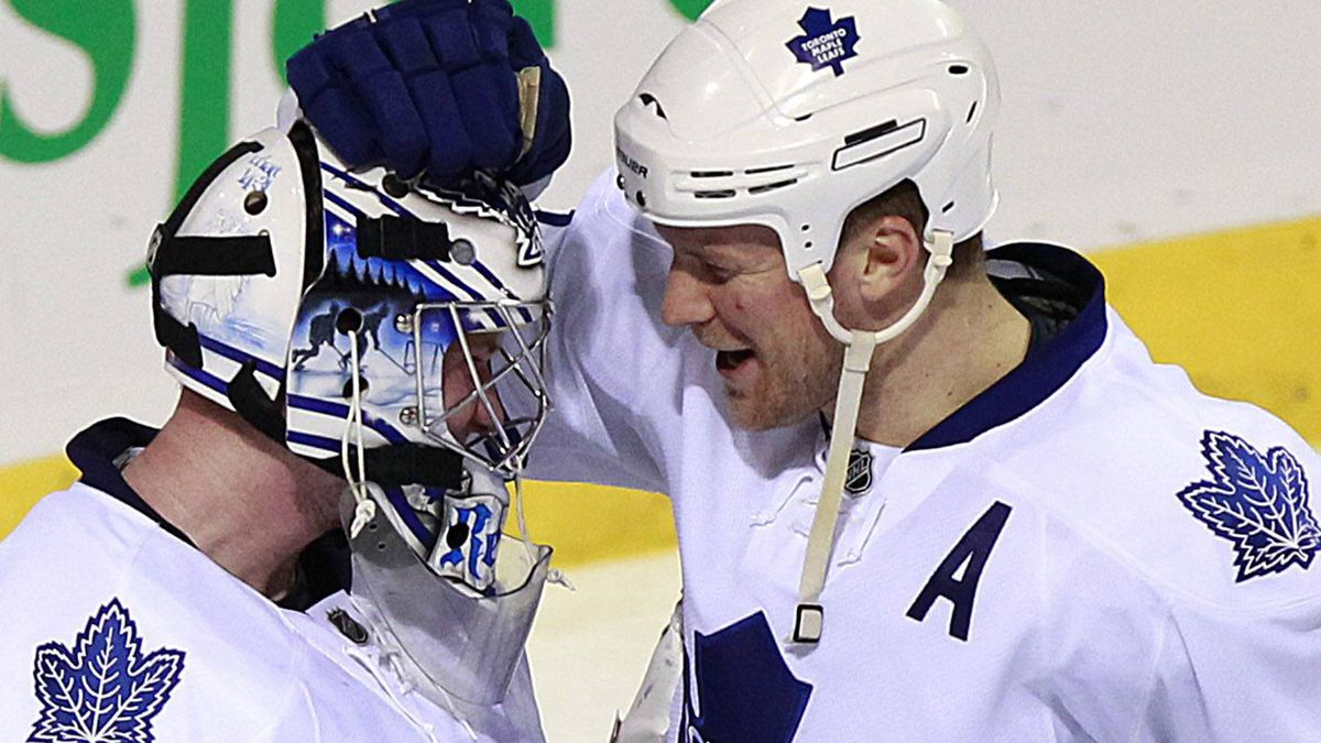 Toronto Maple Leafs goalie James Reimer (34) is congratulated on his win against the Montreal Canadiens by teammate Mike Komisarek (8) following third period NHL hockey action in Montreal, February 24, 2011. REUTERS/Christinne Muschi