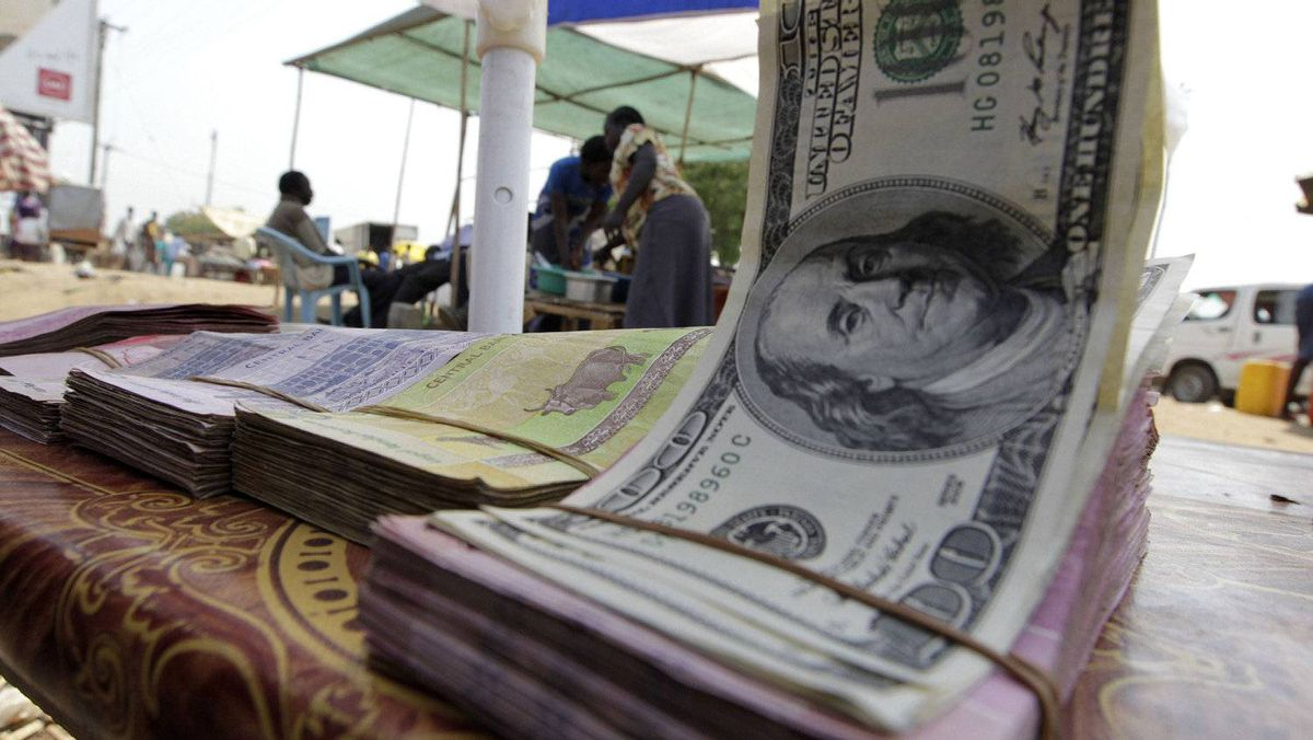 Banknotes are displayed on a roadside currency exchange stall along a street in Juba, South Sudan.