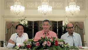 This photo taken on May 18, 2011 and made available by the Straits Times shows Singapore Prime Minister Lee Hsien Loong (C) together with his two deputies, Teo Chee Hean (L) and Tharman Shanmugaratnam duting a press conference to announce the new Cabinet in Singapore.