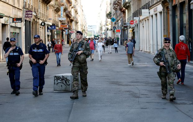 French police hunt for suspect after bomb left in Lyon leaves 13 people wounded