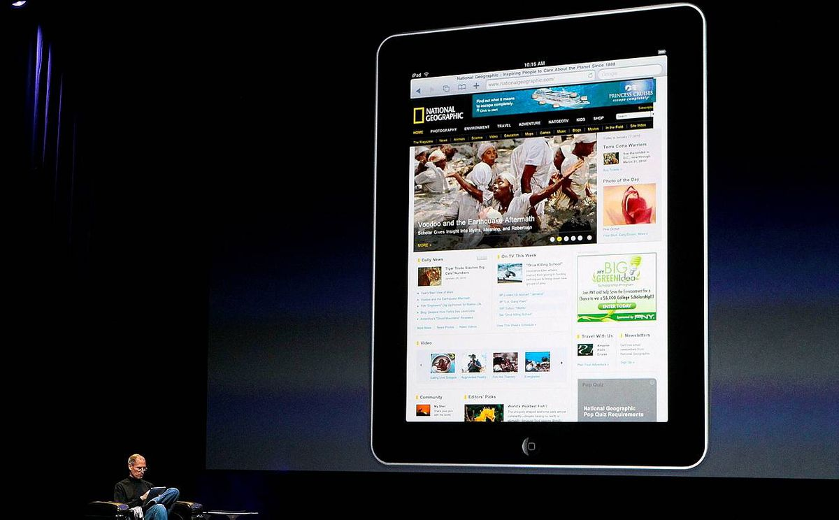 "Apple Chief Executive Officer Steve Jobs holds the new "" iPad"" during the launch of Apple's new tablet computing device in San Francisco, California,"
