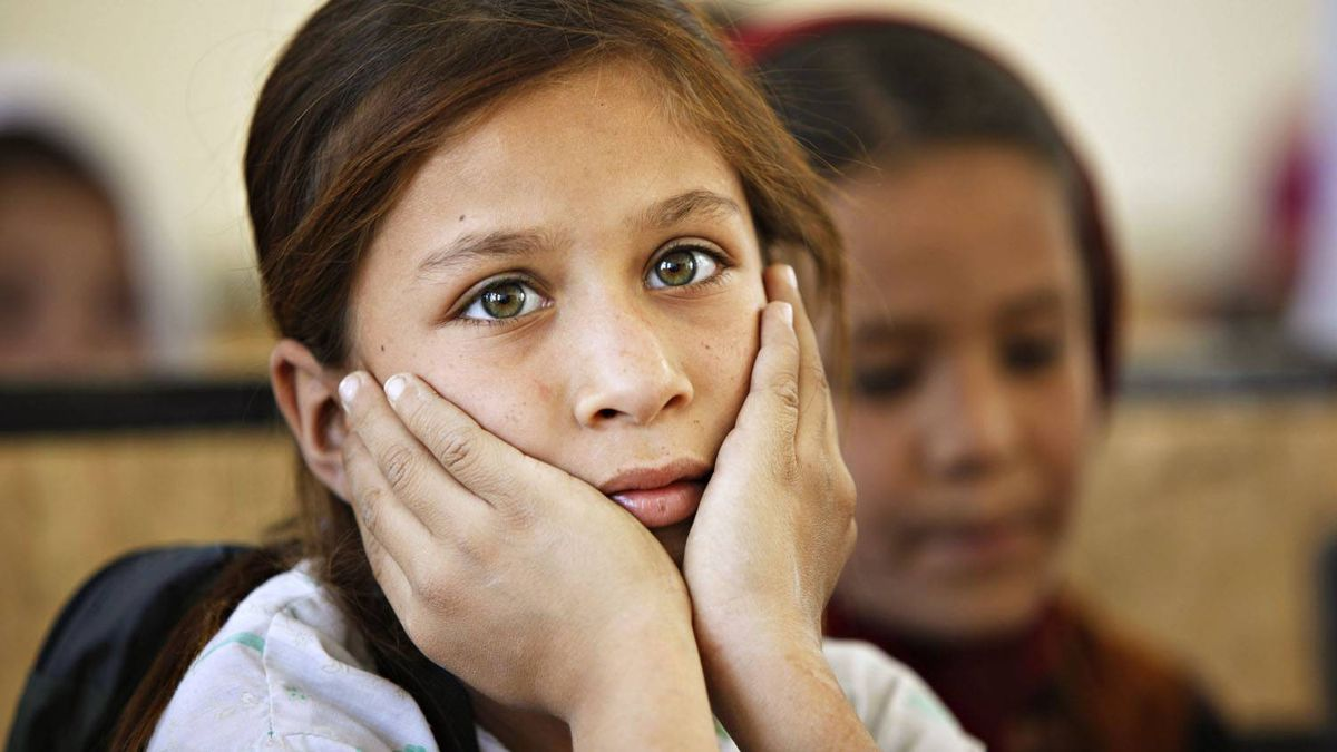 A schoolgirl sits in a classroom at Syed Pasha school, built by Canadian troops, near Kandahar Air Field in Afghanistan. Tuesday March 8, 2011 marks the 100th International Women's Day.