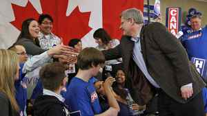 Prime Minister Stephen Harper greets supporters during an election campaign rally in Guelph on April 4, 2011.