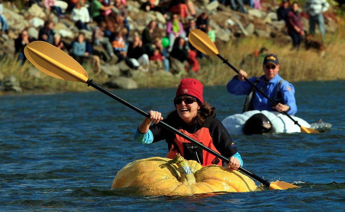 Lisa Evans, of Roslindale, Mass., leads Peter Geiger, of Lewiston, Maine, during the paddleboat competition at the fourth annual Damariscotta Pumpkinfest Regatta, Sunday, Oct. 11, 2009, in Damariscotta, Maine. The event started a few years ago when a couple of local guys looked for something to do with a 700-pound pumpkin they had shown at a county fair. They hollowed it out, attached a motor and launched what has become a wacky race that now attracts more than a thousand people to town.