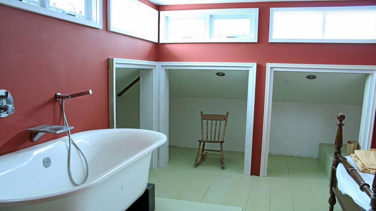 The second floor bedroom, with bathtub.
