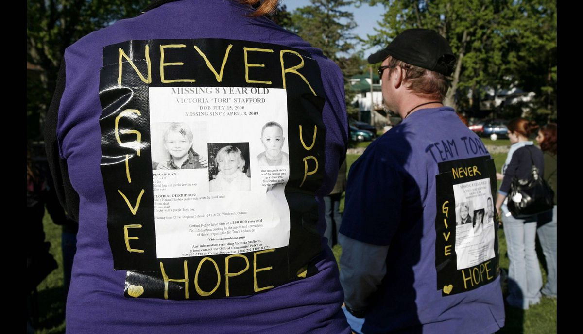 Trish and Jeremy Millson wear shirts in support of then missing Victoria (Tori) Stafford, at a vigil ceremony in Ingersoll, Monday May, 18, 2009.