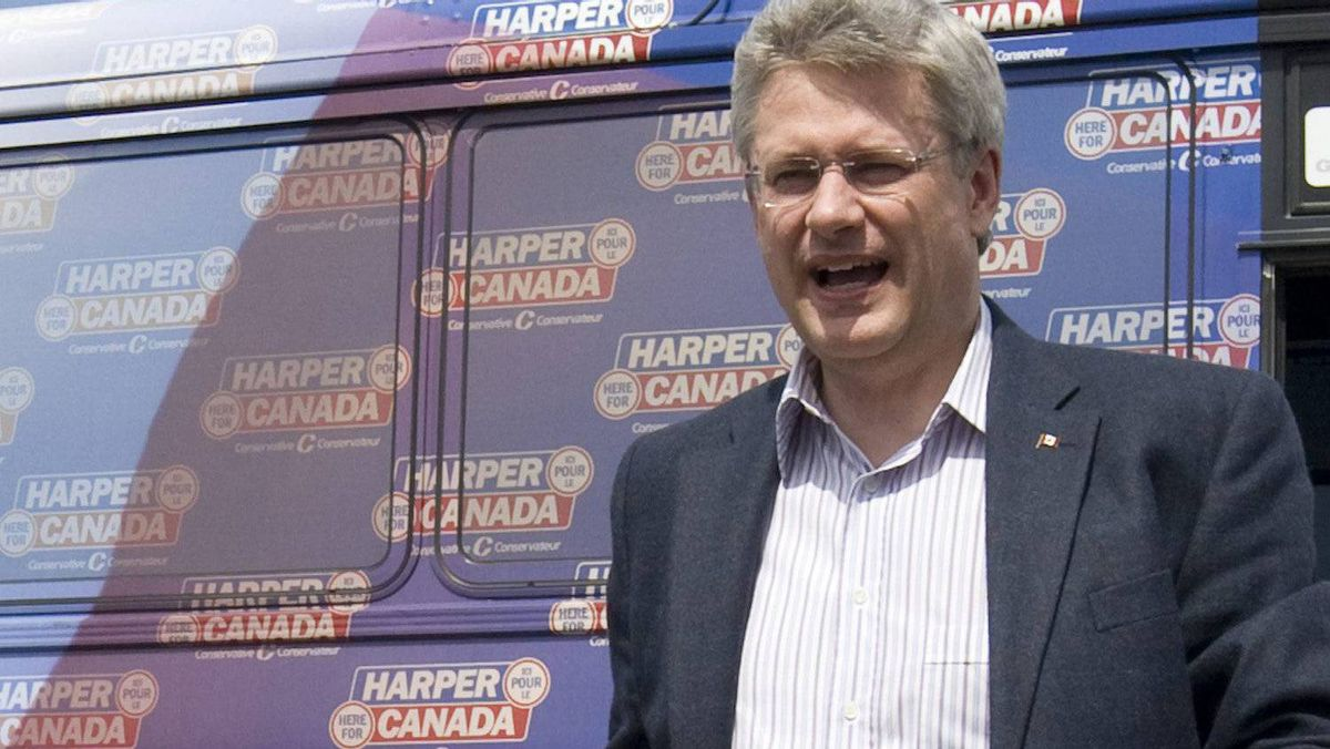 Conservative Leader Stephen Harper steps off the campaign bus in Toronto, Saturday April 23, 2011.