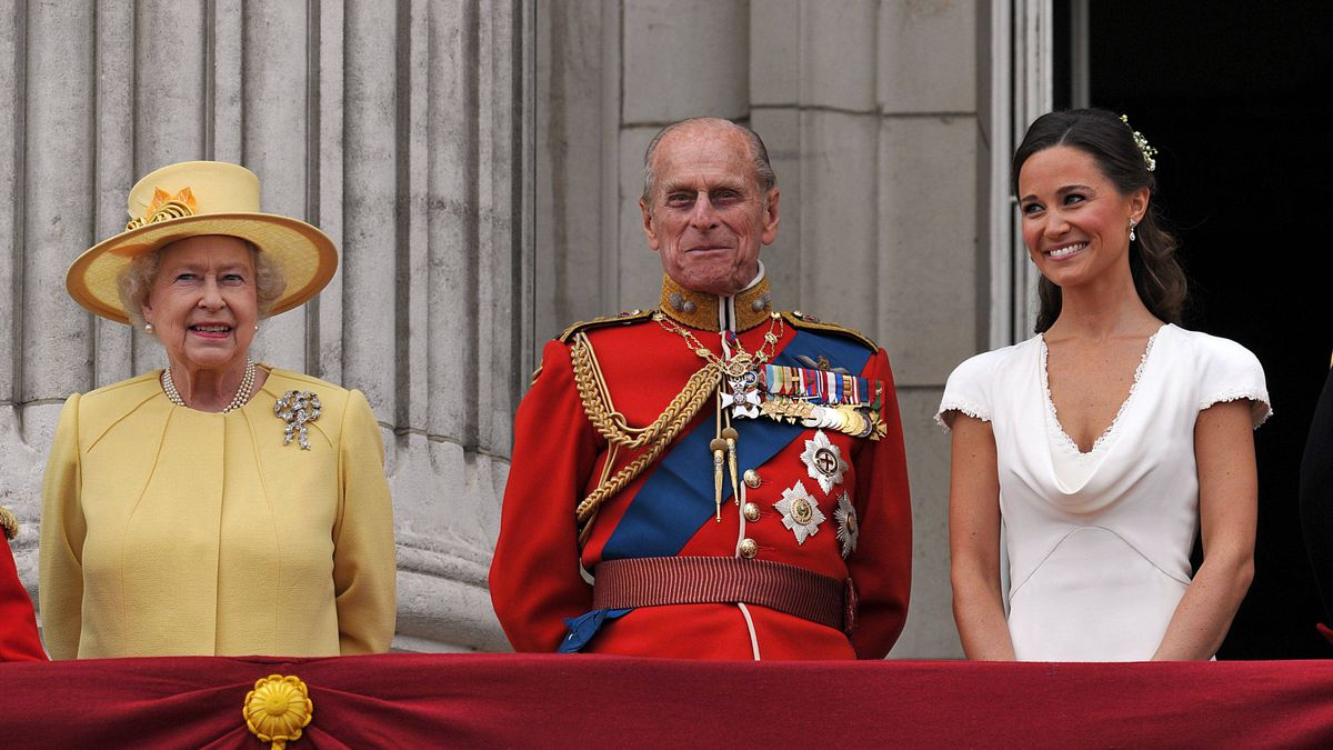 Queen Elizabeth II, Prince Philip, Duke of Edinburgh and Pippa Middleton on the balcony at Buckingham Palace after the Royal Wedding of Prince William to Catherine Middleton on April 29, 2011 in London, England. The marriage of the second in line to the British throne was led by the Archbishop of Canterbury and was attended by 1900 guests, including foreign Royal family members and heads of state. Thousands of well-wishers from around the world have also flocked to London to witness the spectacle and pageantry of the Royal Wedding.