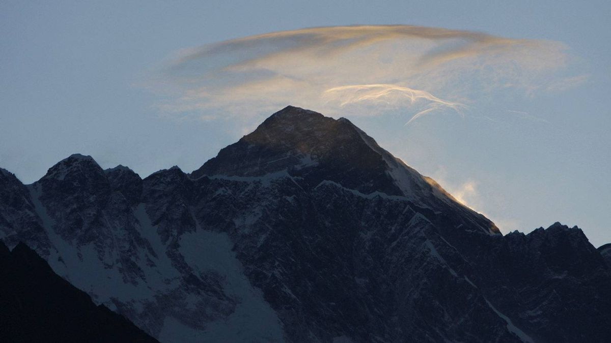 In this May 19, 2010 file photo, clouds hover above the world's highest peak Mount Everest, as seen from Syangboche, about 125 kilometres northeast of Katmandu, Nepal. Mountaineering Department official Gyanendra Shrestha said Monday, May 21, 2012, that a German, a Nepal-born Canadian and a Korean died Saturday while descending from the 8,850-metre summit.