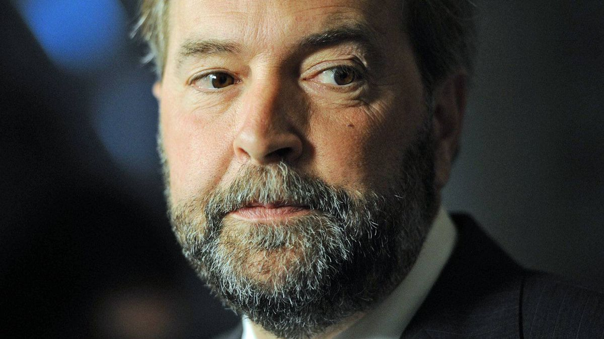 NDP leadership contender Thomas Mulcair speaks to reporters in the foyer of the House of Commons on Sept. 19, 2011.