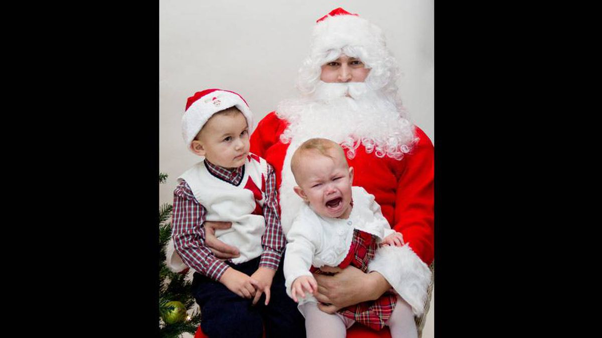 Jennifer Bolzicco writes: This is a picture of my son Ethan (2.5) and daughter Sophia (1) with Santa, who happens to be their dad. Ethan was shy and wouldn't make eye contact and my daughter lost it screaming!