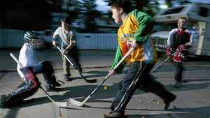 Kids play road hockey in Edmonton on Wednesday, September 22, 2004. Active Healthy Kids Canada released its annual Report Card on Physical Activity for Children and Youth on Tuesday which paints a grim picture of the activity levels of many Canadian youngsters.