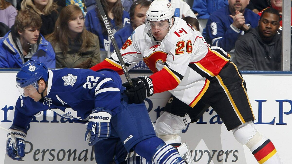 Francois Beauchemin #22 of the Toronto Maple Leafs runs into Ales Kotalik #26 of the Calgary Flames during game action at the Air Canada Centre January 15, 2011 in Toronto, Ontario, Canada. The Flames won 2-1 in a shootout. (Photo by Abelimages/Getty Images)