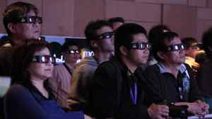 Visitors view 3D movie.
