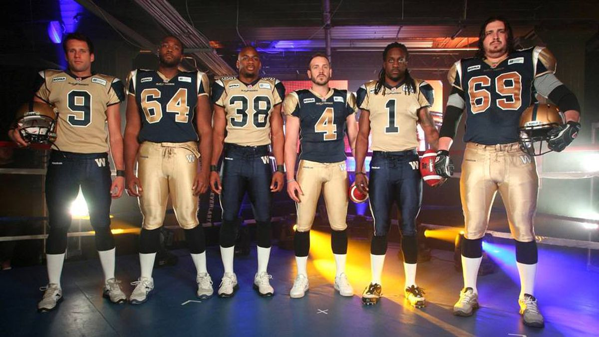 Blue Bombers players show off their new uniforms.