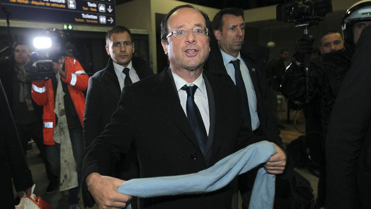 French presidential candidate Francois Hollande arrives at Brive airport after the first round of voting, Sunday, April 22, 2012, in Brive, France.