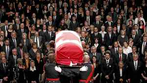 The coffin containing NDP Opposition Leader Jack Layton is carried away during his state funeral in Toronto August 27, 2011. More than 2,000 people turned out Saturday, August 27, 2011 for the state funeral.
