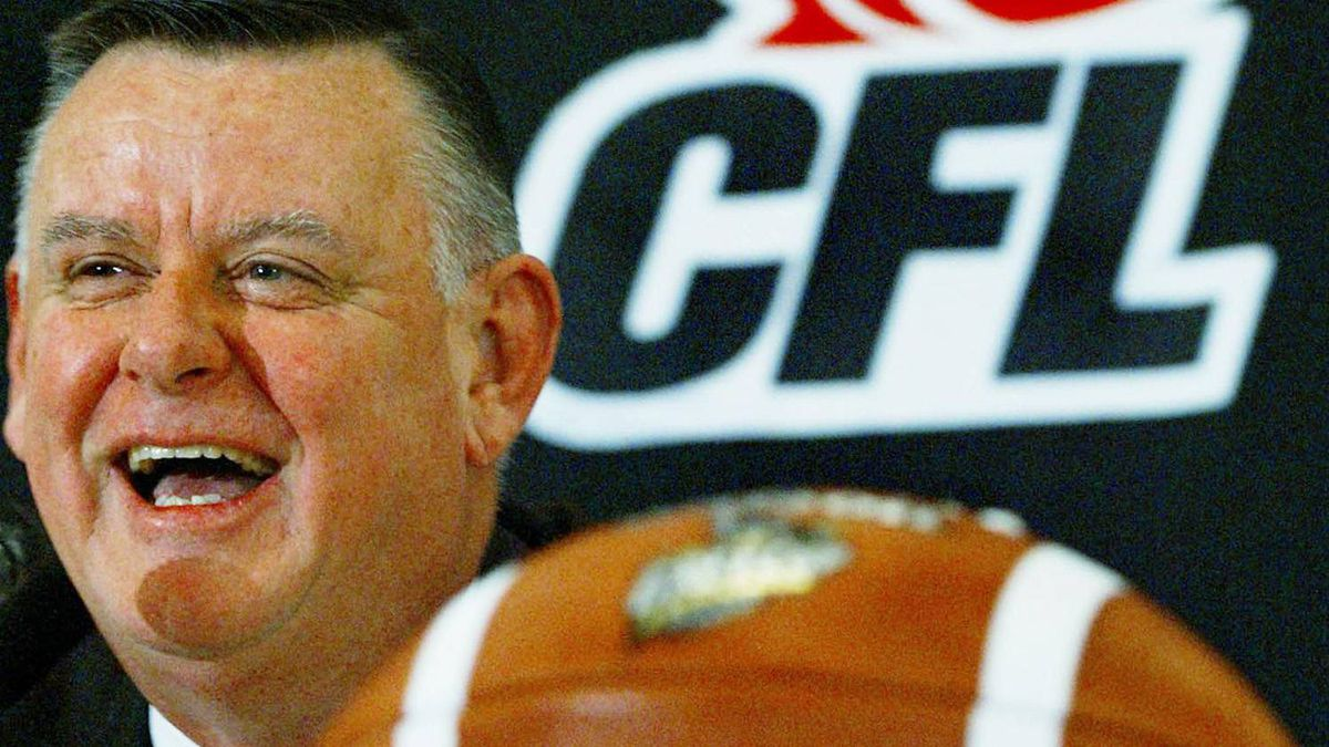 Canadian Football League interim commissioner David Braley laughs at a question during a news conference in Edmonton Friday, November 22, 2002. (CP PHOTO/Kevin Frayer)
