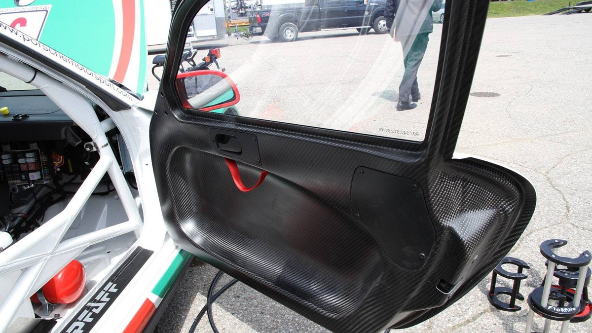 Although the body shell of GT3 Cup cars is the same as the one used on Porsche street cars, it's reinforced with a steel roll cage. Carbon fiber doors reduce weight, and glass side windows are replaced with lightweight polycarbonate.
