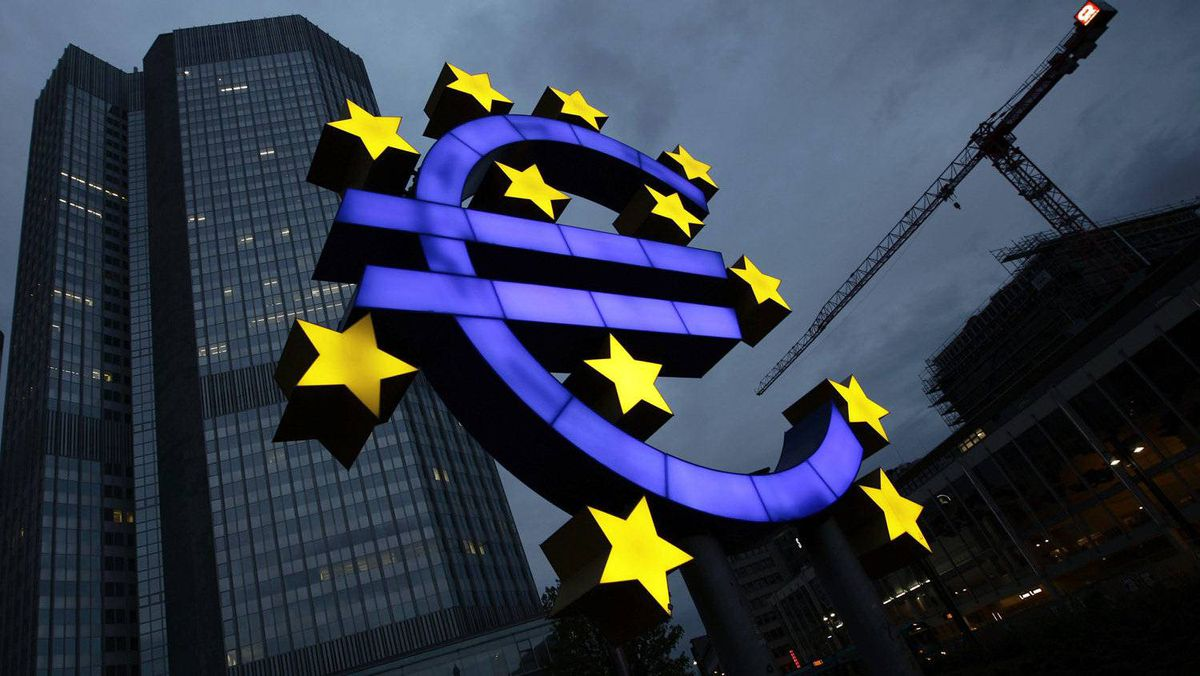 The illuminated euro sign is seen in front of the headquarters of the European Central Bank in Frankfurt.