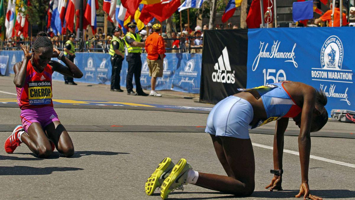 Winner of the women's division of the Boston Marathon Sharon Cherop of Kenya (L) and second place finisher Jemima Jelagat Sumgong of Kenya react after crossing the finish line of the 116th Boston Marathon in Boston, Massachusetts April 16, 2012.