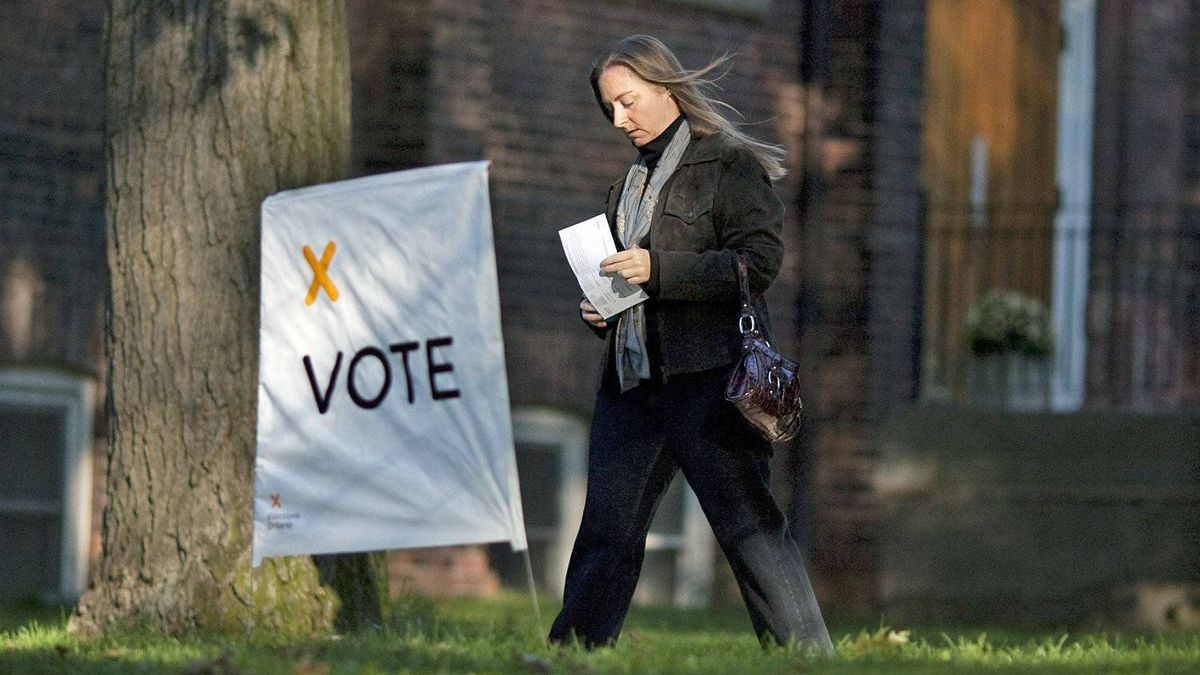 A woman makes her way to a Toronto polling station as voters cast their ballots in the Ontario election on Oct. 6, 2011.