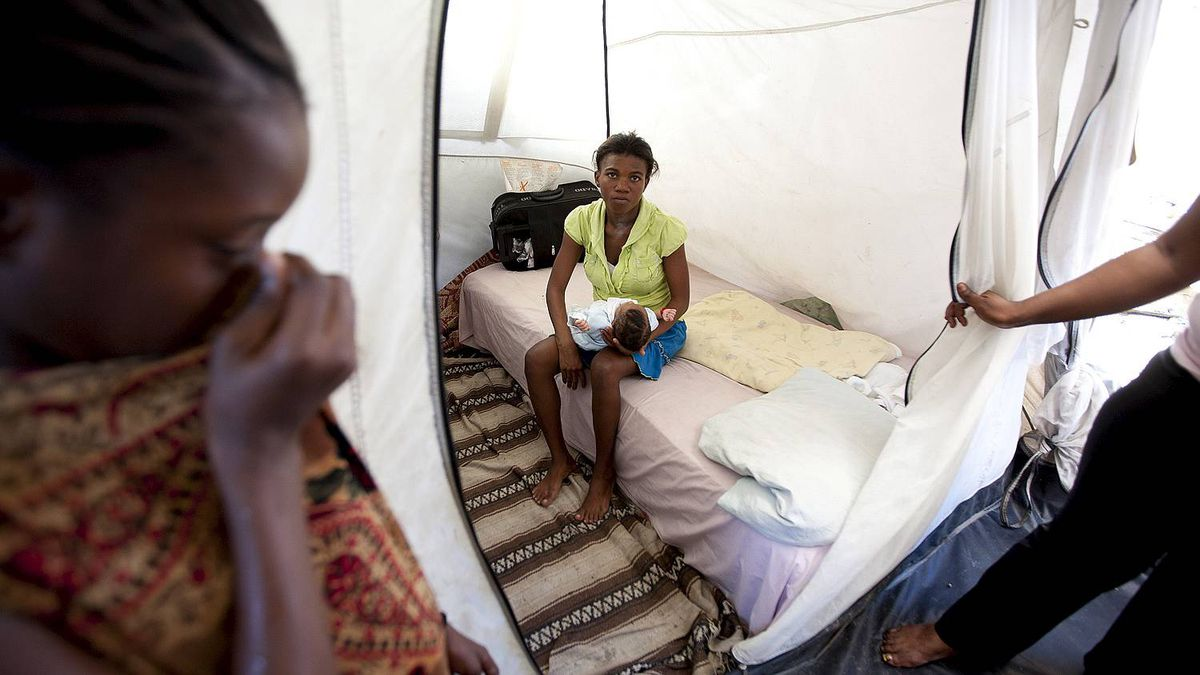Mirlande Luis, 22, holds her 22-day-old son her friend who was the result of a gang rape that she said happened when she tried to use the portable toilets at the Champs de Mars displaced persons camp in Port-au-Prince, Haiti, situated near the presidential palace.