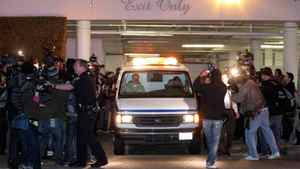 The body of Whitney Houston is removed from the Beverly Hilton Hotel Saturday Feb. 11, 2012 in Beverly Hills Calif. Whitney Houston, who ruled as pop music's queen until her majestic voice and regal image were ravaged by drug use, erratic behavior and a tumultuous marriage to singer Bobby Brown, died Saturday. She was 48.