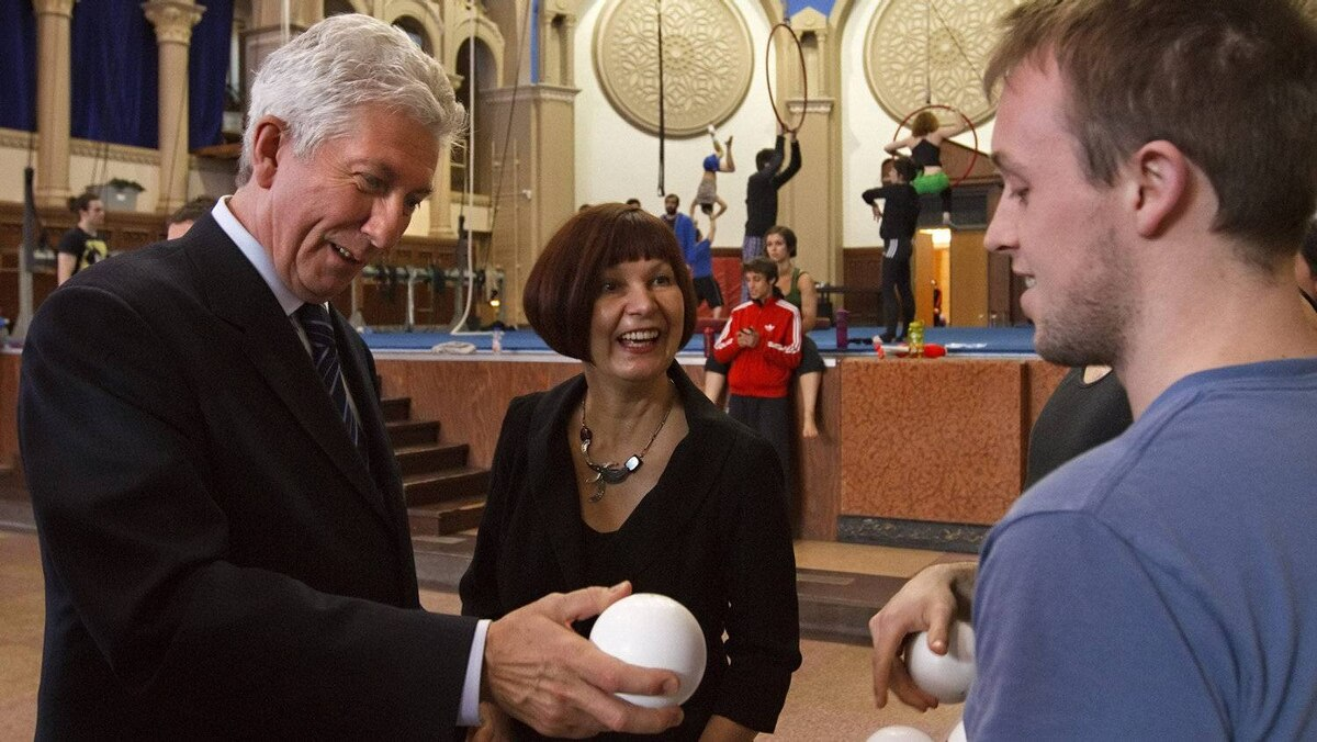 Bloc Quebecois Leader Gilles Duceppe and his wife Yolande Brunelle, centre, chat with a juggler as they visit the Ecole de Cirque de Quebec during the campaign stop in Quebec City on Friday April 15, 2011.