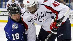 Tampa Bay Lightning's Adam Hall, left, and Washington Capitals' Joel Ward battle for the puck during the first period of an NHL hockey game, Saturday, Feb. 18, 2012, in Tampa, Fla. The Lightning won 2-1. (AP Photo/Mike Carlson)
